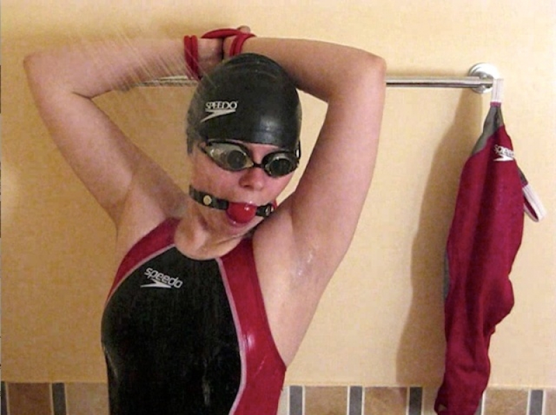 Gagged and bounded in black-red LZR swimsuit