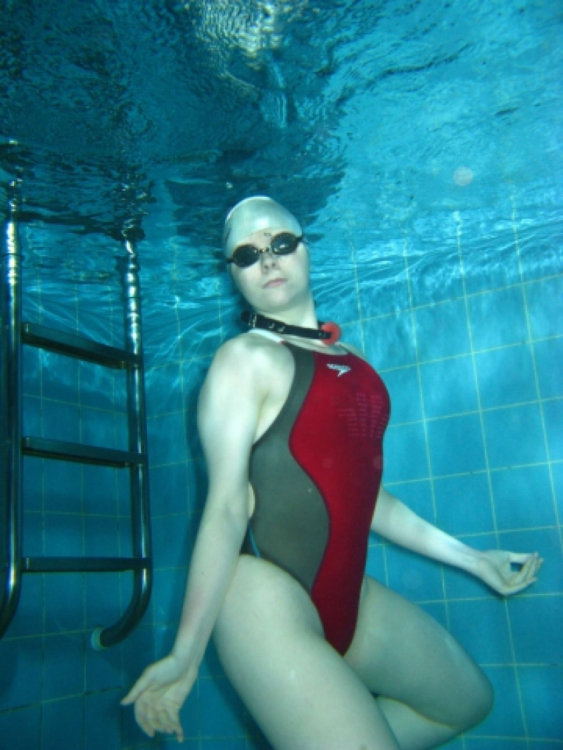 Gagged and bounded underwater in red Fastskin suit